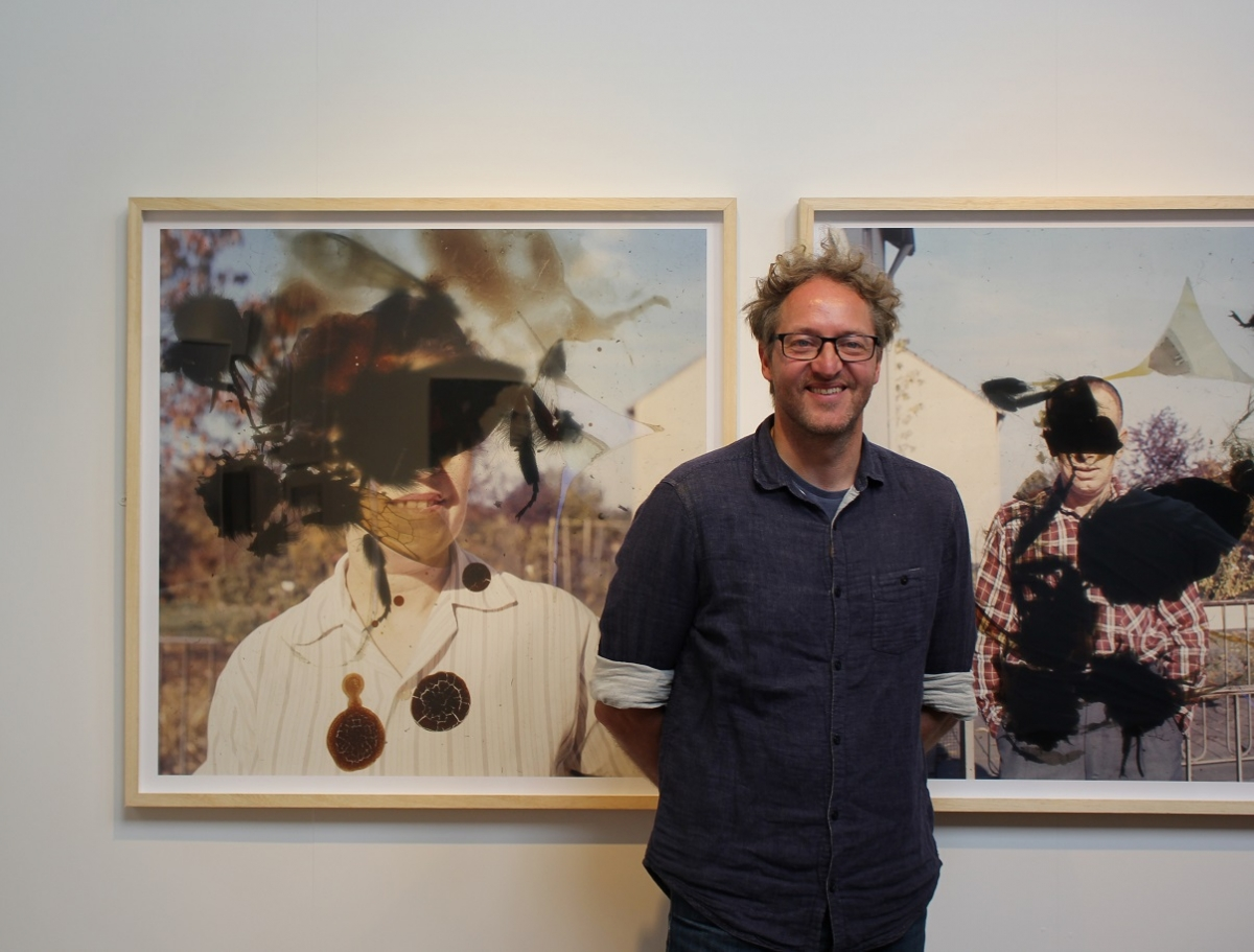 Winner of The Storycatchers Prize, Clay Smith, alongside his work