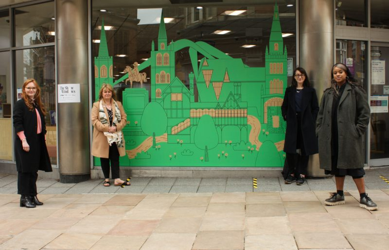 Left to Right: Ella Lewis Williams; TrishWillets; Charlie Levine & Cara Pickering in front of Ben Javens 'Coz as Oz' artwork installation